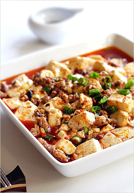 Super delicious mapo tofu featuring cut up tofu and minced meat in a bowl.