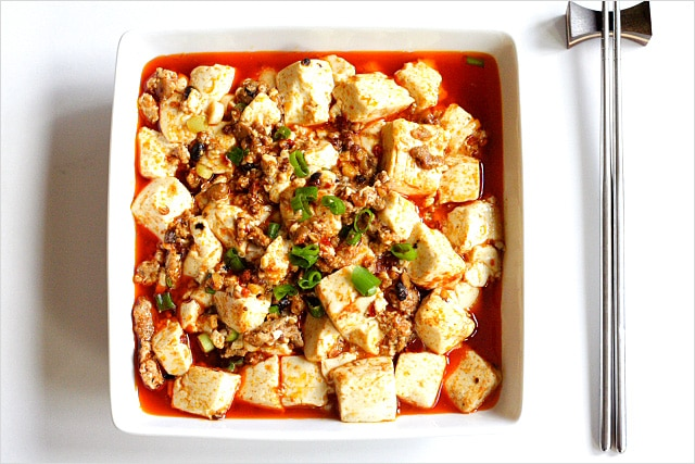 Easy mapo tofu recipe with delicious tofu and minced meat, with scallions on top.
