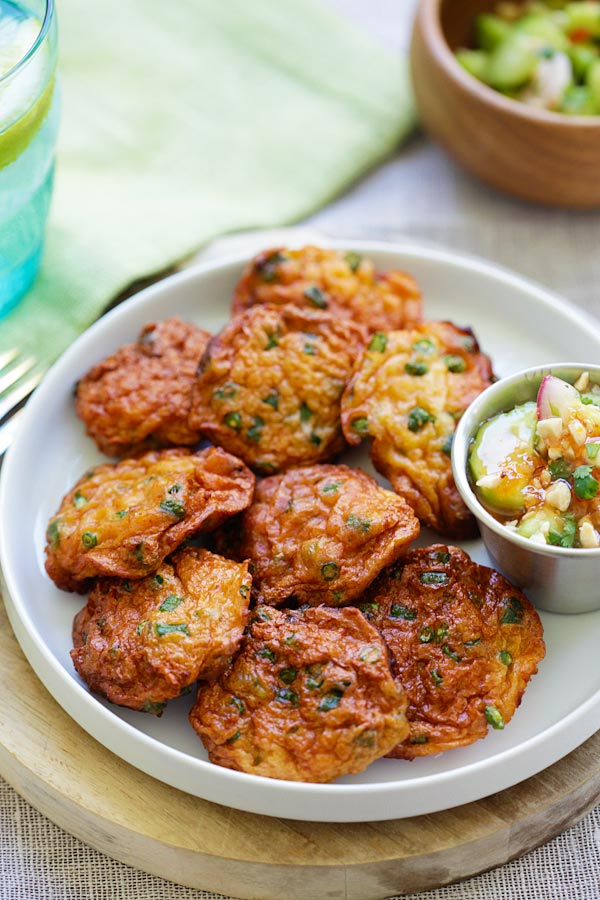 Easy and quick authentic Thai Fish Cakes in a plate with a side of dipping sauce.
