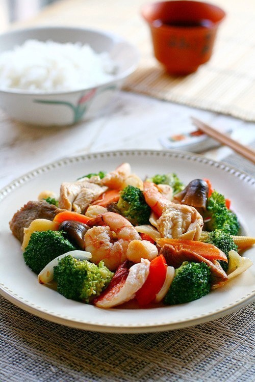 Easy and delicious homemade takeout style happy family stir fry served in a plate.