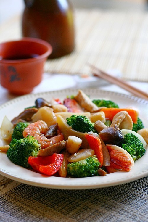 Chinese happy family vegetables and seafood stir fry in brown sauce.