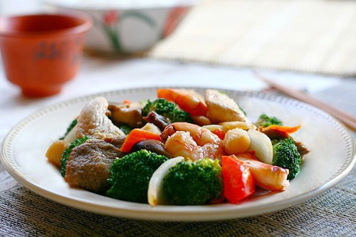 American-Chinese dish with seafood, meat, and vegetables cooked in brown sauce.