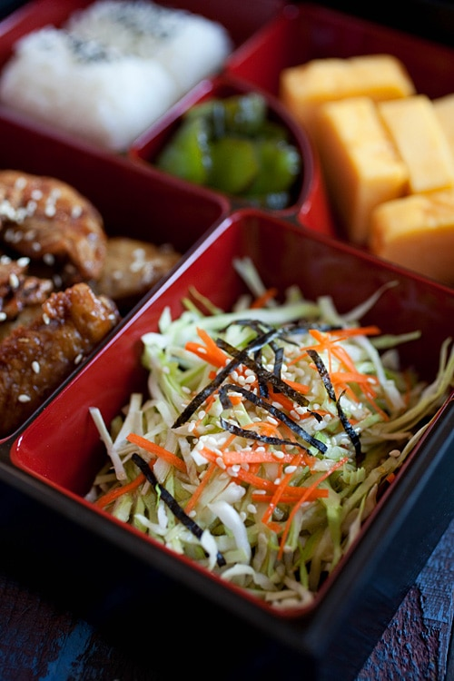Close up of Japanese salad in a bento box.