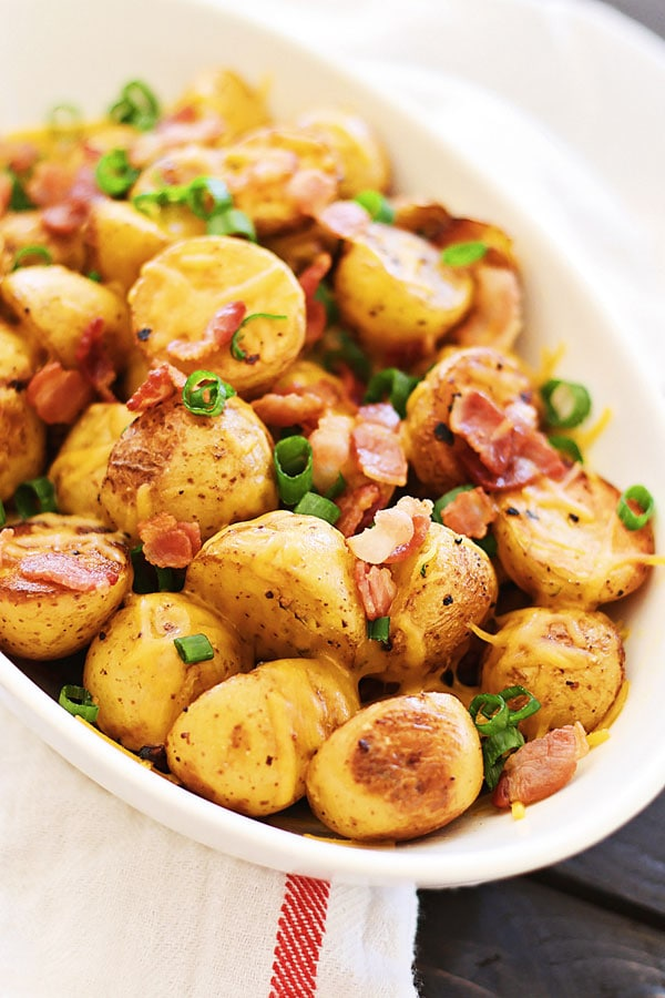 Cheesy Roasted Potatoes with Bacon in a serving dish.