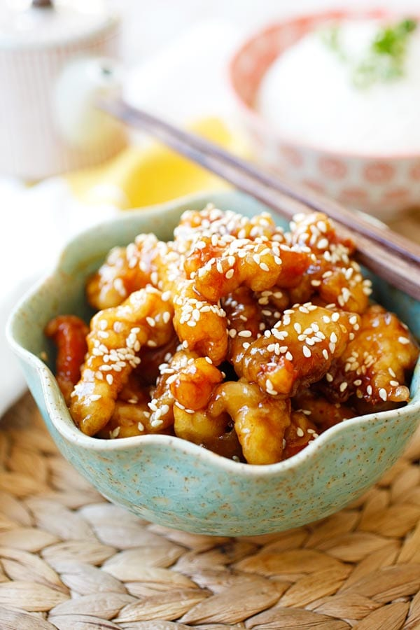 Sesame chicken with sesame sauce and sesame seeds.