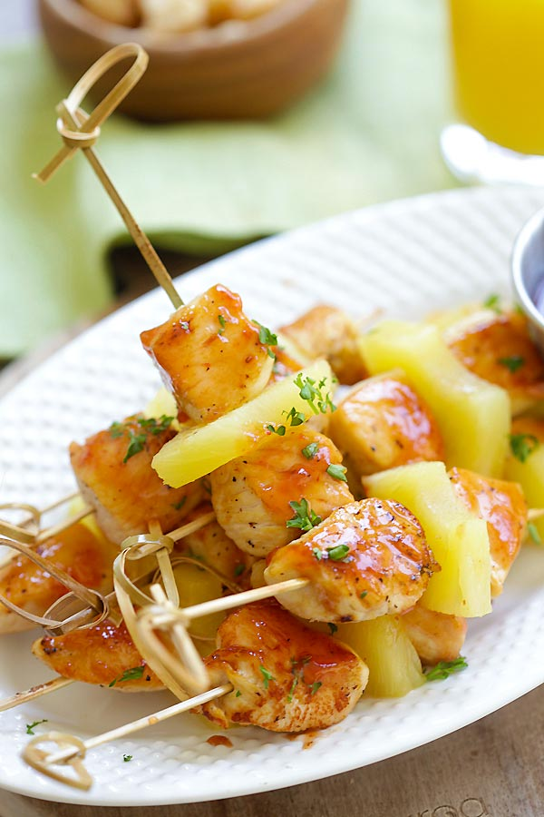 Hawaiian style grilled chicken on skewers with pineapple.