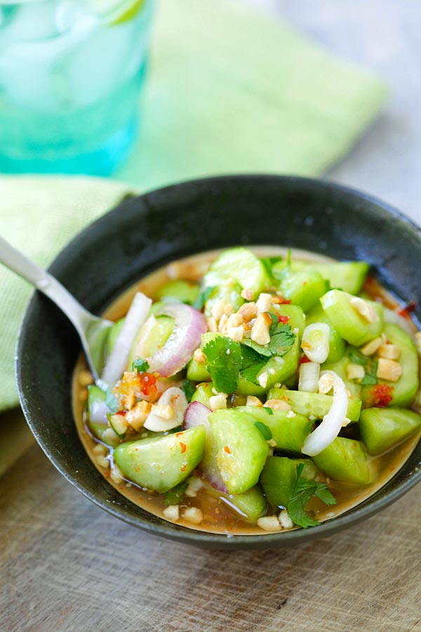 Cucumber Salad recipe made as a side dish in a bowl, covered in delicious Thai sauce.