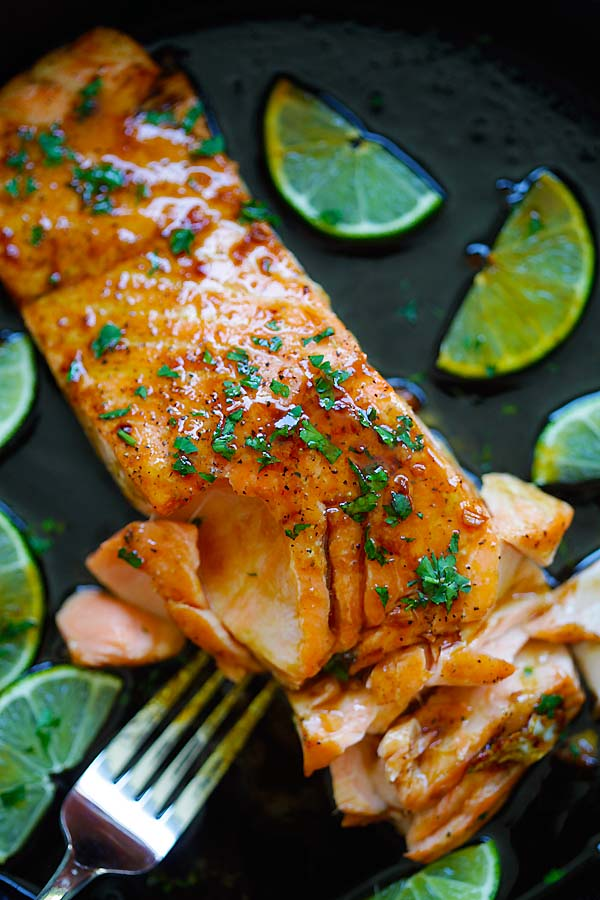 Healthy homemade sweet and zesty salmon with honey, lime juice and soy sauce in a skillet.