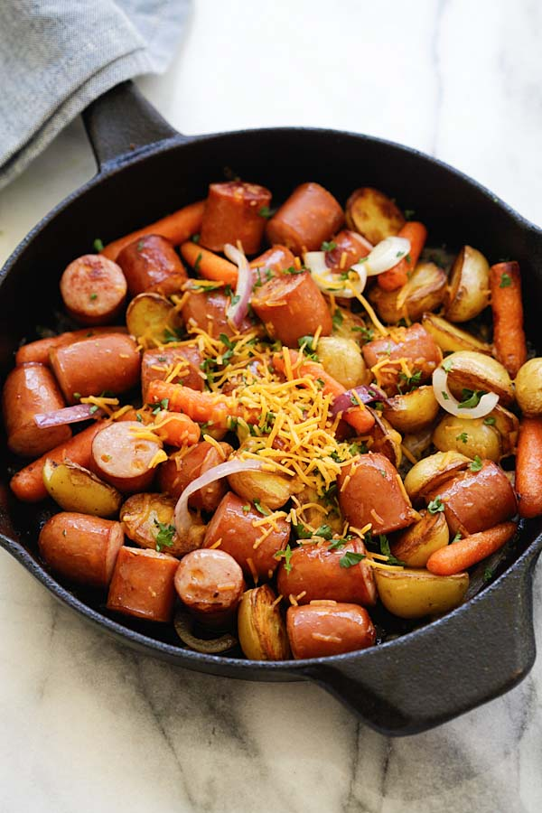 Easy and quick smoked sausage with potatoes and carrots on a skillet.