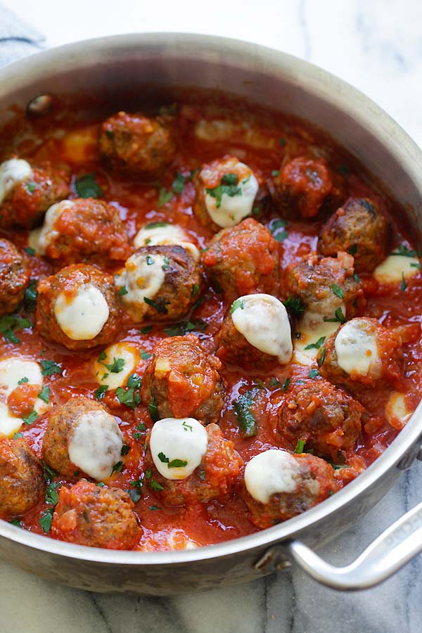 Easy casserole recipe with ground beef meatballs in tomato sauce topped with mozzarella cheese.