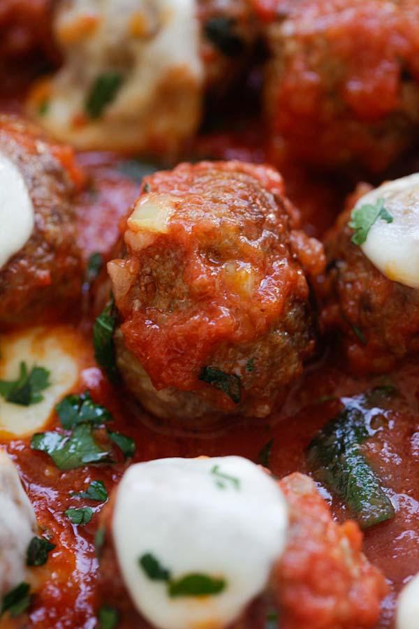 Italian meatballs covered in homemade tomato sauce and mozzarella cheese.
