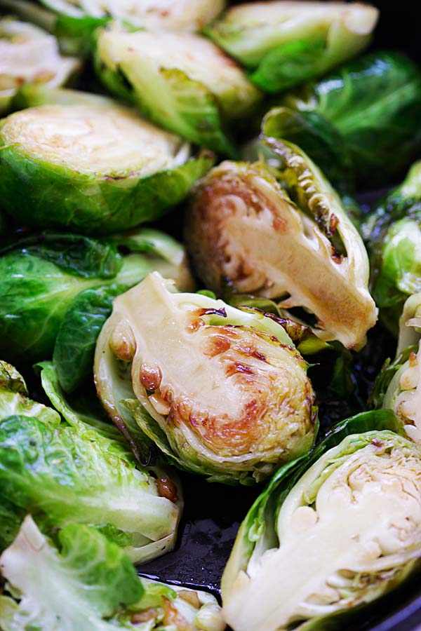 Close up healthy sauteed Brussels sprouts with honey and balsamic vinegar.