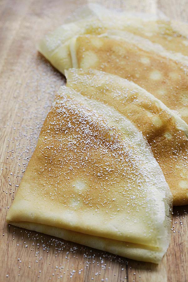 French crepes pancakes dusted with powdered sugar.
