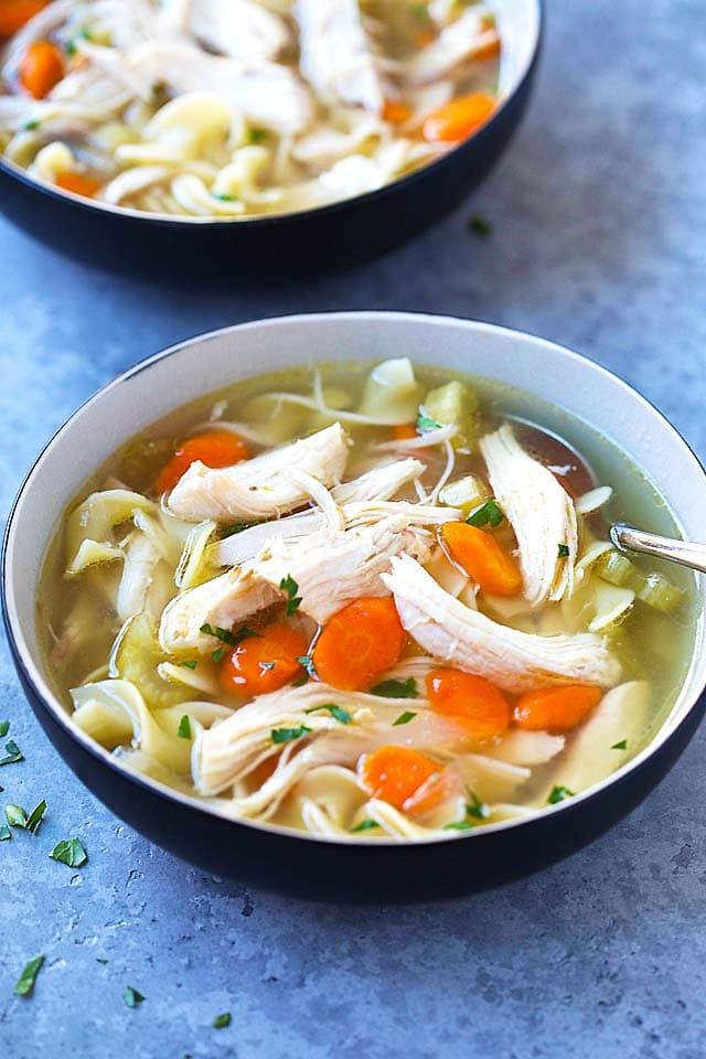 Pressure Cooker Chicken Noodle Soup in two bowls, ready to be served.