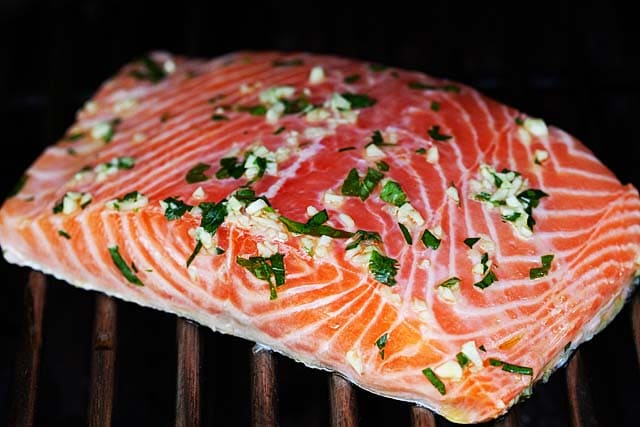 Grilling salmon with skin on a gas grill.