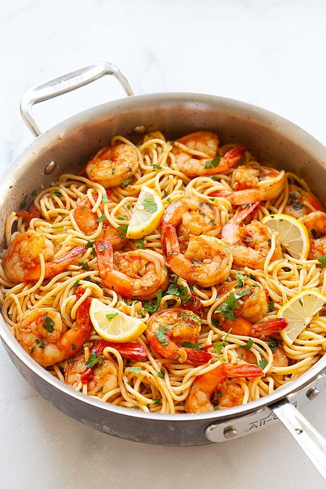 Shrimp and pasta cooked in a skillet.