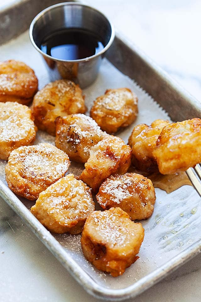 Caramelized fried bananas with a fork.